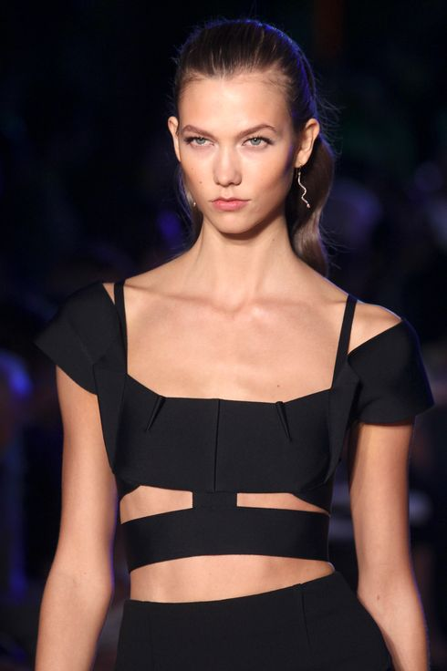 US model Karlie Kloss presents a creation by French designer Roland Mouret during the Spring/Summer 2012 ready-to-wear collection show, on September 30, 2011 in Paris. AFP PHOTO/PIERRE VERDY (Photo credit should read PIERRE VERDY/AFP/Getty Images)