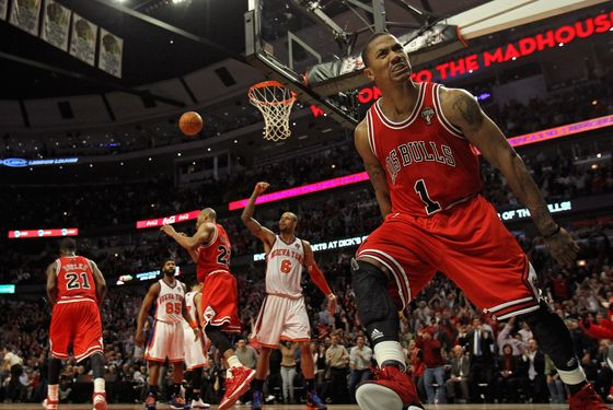 Derrick Rose #1 of the Chicago Bulls lets out a scream after dunking the ball against the New York Knicks at the United Center on March 12, 2012 in Chicago, Illinois. The Bulls defeated the Knicks 104-99.