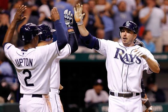 ST. PETERSBURG, FL - SEPTEMBER 27:  B.J. Upton #2 and Evan Longoria #3 of the Tampa Bay Rays congratulate Matt Joyce #20 after his three run home run against the New York Yankees during the game at Tropicana Field on September 27, 2011 in St. Petersburg, Florida.  (Photo by J. Meric/Getty Images)