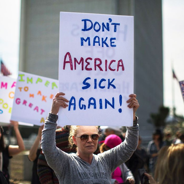People protest Trump administration policies that threaten the Affordable Care Act, Medicare and Medicaid, near the Wilshire Federal Building on January 25, 2017 in Los Angeles, California.