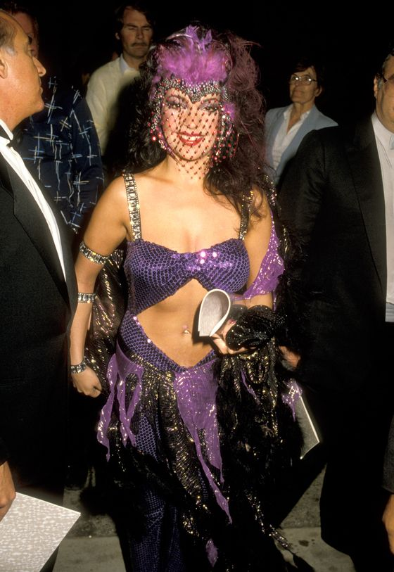 Ah, the '80s. The Prince muse topped off her <i>Purple Rain</i> ensemble with a Las Vegas headpiece.