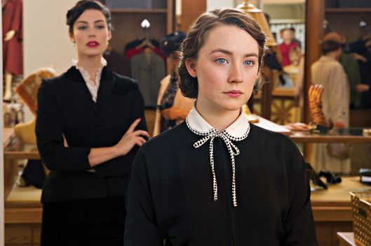 "Jessica Paré as ""Miss Fortini"" and Saoirse Ronan as ""Eilis"" in BROOKLYN. Photo by Kerry Brown.  © 2015 Twentieth Century Fox Film Corporation All Rights Reserved"