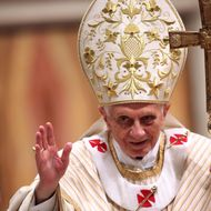 Pope Benedict XVI waves to the faithfuls as he leaves St. Peter's Basilica at the end of the Christmas night mass on December 24, 2012 in Vatican City, Vatican.
