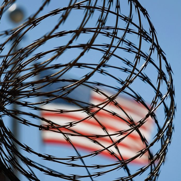 GUANTANAMO BAY, CUBA - OCTOBER 27: (EDITORS NOTE: Image has been reviewed by U.S. Military prior to transmission.) A roll of protective wire rings a detainee camp inside the U.S. military prison for
