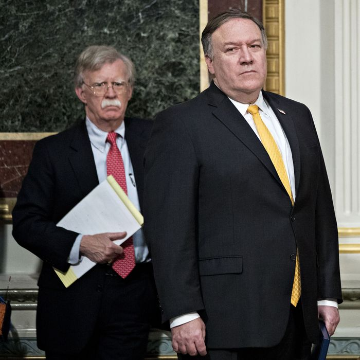 Pompeo (yellow tie) and Bolton ('stache).