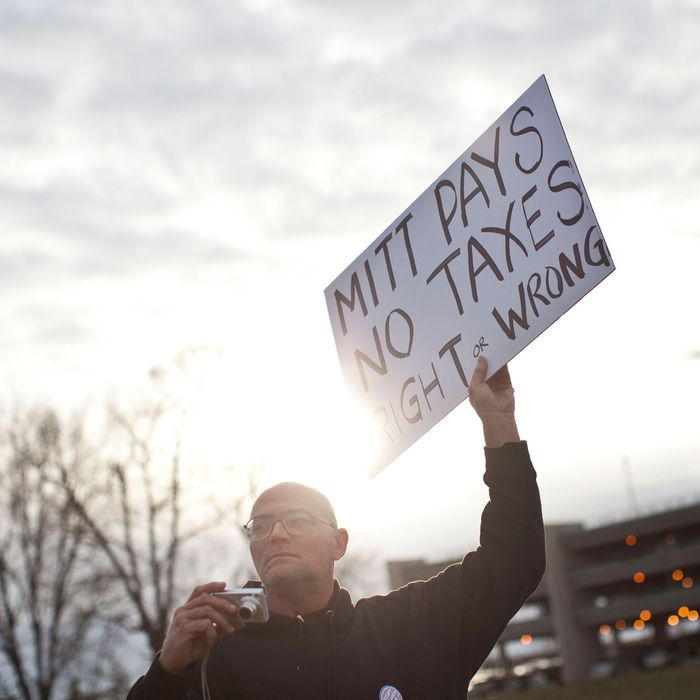 DES MOINES, IA - DECEMBER 29: A protestor affiliated with the Occupy Wall Street movement demonstrates outside the Iowa Democratic Party headquarters on December 29, 2011 in Des Moines, Iowa. Thirteen people were arrested during the protest.