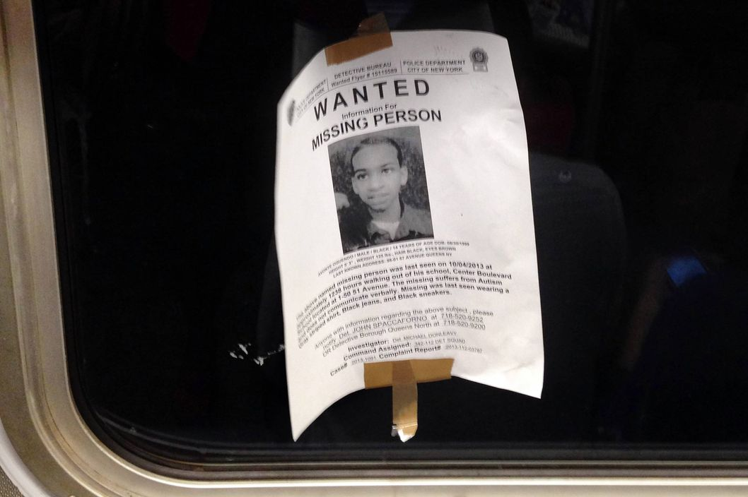 In this Saturday, Oct. 12, 2013 photo, a flyer showing Avonte Oquendo, a missing 14-year-old autistic boy, is taped inside the window of a subway car in New York. New York City police are asking the public to come forward with any possible information about Oquendo, who wandered out of his school in Queens on Oct. 4 and has not been seen since. Hundreds of officers have been searching for the teen, who does not speak. His parents say he loves trains. (AP Photo/Barbara Woike)