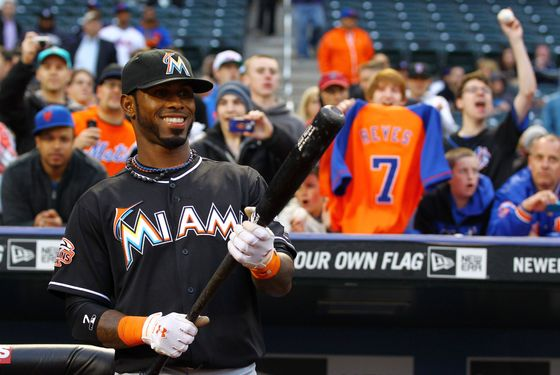 NEW YORK, NY - APRIL 24:  Jose Reyes #7 of the Miami Marlins looks at a tribute video of himself when he played for the New York Mets before his first game back to Citi Field against the Mets on April 24, 2012 at Citi Field in the Flushing neighborhood of the Queens borough of New York City.  (Photo by Al Bello/Getty Images)