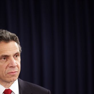 NEW YORK - NOVEMBER 09: New York Governor-elect Andrew Cuomo looks on at a press conference with current New York Governor David Paterson November 9, 2010 in New York City. Cuomo spoke about looming budget cuts, taxes and the state of the economy. (Photo by Mario Tama/Getty Images) *** Local Caption *** Andrew Cuomo