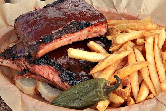 "<a href=""http://www.bryansbarbecue.com/"">Bryan's Black Mountain BBQ</a><br><i>6130 E. Cave Creek Rd., Cave Creek; 480-575-7155</i>     <br>To plum more carnivorous depths of Phoenix's barbecue scene, we picked the brain of local restaurant critic and food writer <a href=""http://penandfork.com/"">Gwen Ashley Walters</a>, who pointed us to Brian Dooley, the former fine-dining chef who left a high-end resort in Scottsdale to cook barbecue. ""Smoked six hours over pecan wood, Bryan's pork spare ribs defy barbecue-style classification,"" she tells us of her favorite ribs. ""Bark-crusted and toothy (nothing worse than meat so flabby it falls off the bone), these ribs are a magical amalgamation of smoke, spice, heat, and chew."""