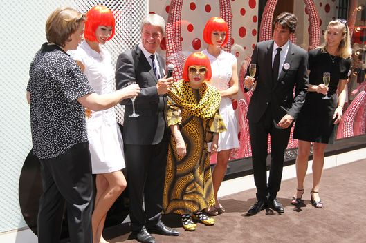 Japanese artist, Yayoi Kusama (C), with Louis Vuitton Chairman and CEO, Yves Carcelle (L) and incoming CEO Jordi Constans (R) attend the Louis Vuitton and Yayoi Kusama Collaboration Unveiling at Louis Vuitton Maison on Fifth Avenue on July 10, 2012 in New York City.