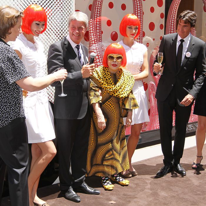 Yayoi Kusama with Louis Vuitton's Yves Carcelle and Jordi Constans.
