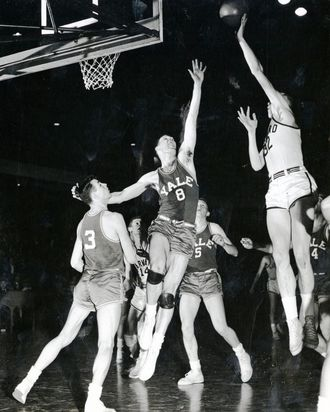 Ed Smith '51 sinks the winning basket to beat Yale, 57-55, at Boston Arena March 3, 1950.