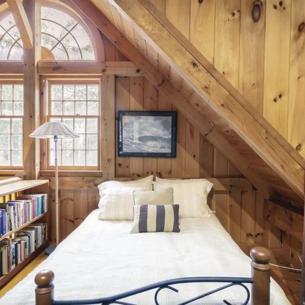 Get Cozy Under the Rustic Beams at a Woodland Hideaway