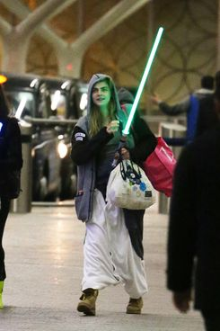 Cara Delevingne and Michelle Rodriguez duel with lightsabers in Paddington Train Station on January 28, 2014. The pair were seen swinging their 'Star Wars' weapons around dueling each other before boarding their train.