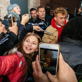 """ad9a8e4c5 A fan takes a selfie with Jake Paul outside his pop up store in New York  City. Photo  Victor Llorente. """""""