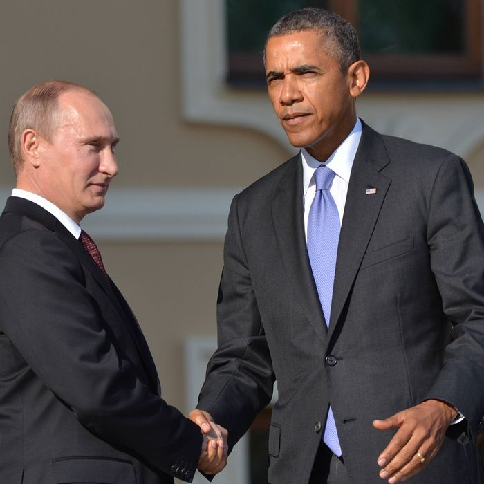 In this handout image provided by Host Photo Agency, Russian President Vladimir Putin (L) greets US President Barack Obama during an official welcome of G20 heads of state and government, heads of invited states and international organizations at the G20 summit on September 5, 2013 in St. Petersburg, Russia. The G20 summit is expected to be dominated by the issue of military action in Syria while issues surrounding the global economy, including tax avoidance by multinationals, will also be discussed during the two-day summit.