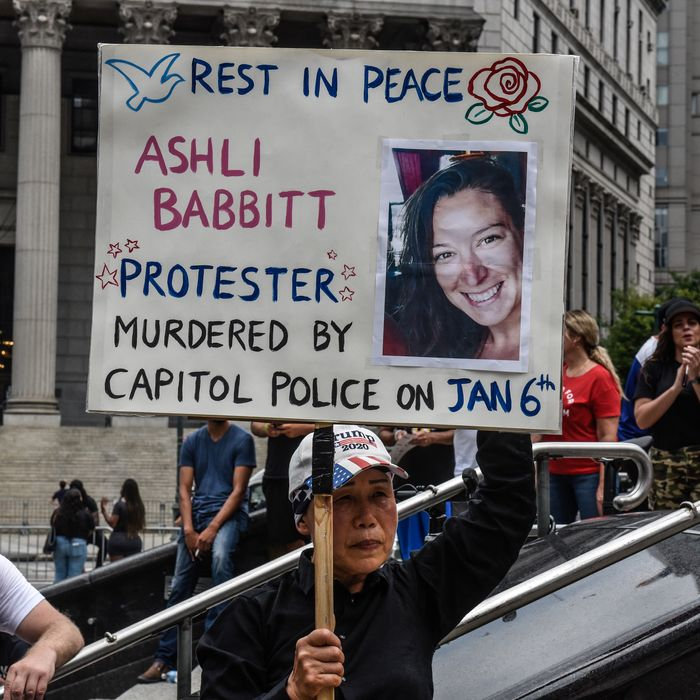 Protester with an Ashli Babbitt poster.