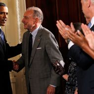 President Barack Obama (L) greets Sen. Arlen Specter (D-PA) (2nd-L) during a reception in honor of Jewish American Heritage Month May 27, 2010 in the East Room of the White House in Washington, DC. The reception was to celebrate Jewish American heritage and its contributions to American culture.