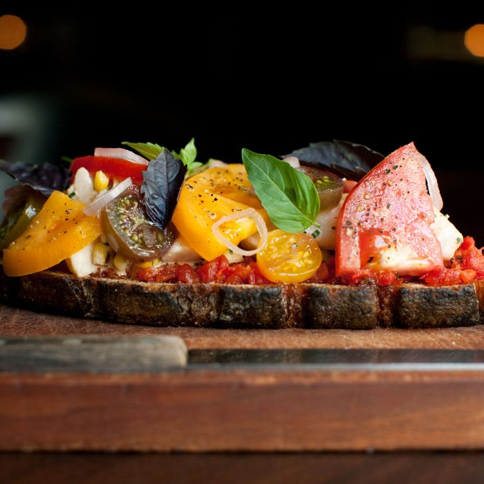 The toast is topped with Hawaiian blue prawns, heirloom tomatoes, and Ssäm Sauce.