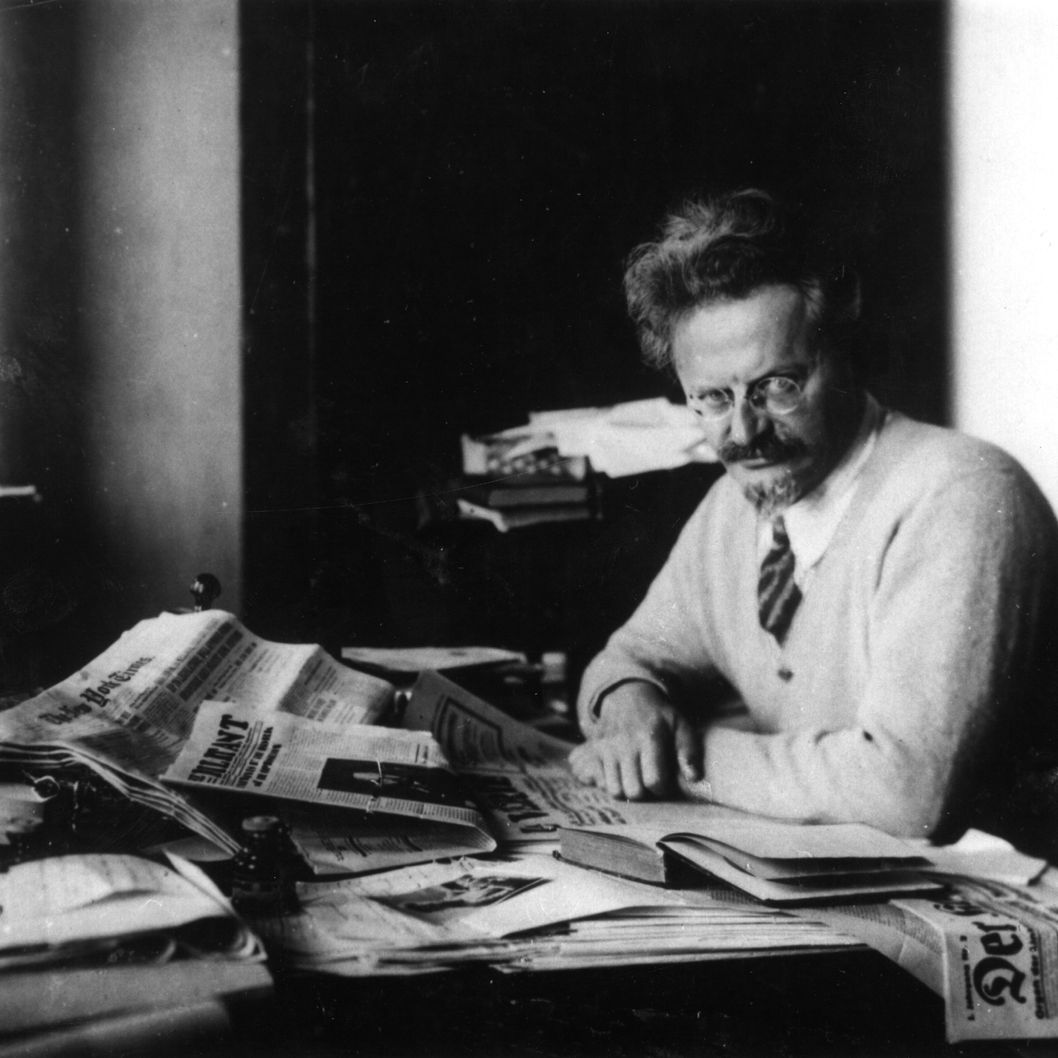 Russian revolutionary Leon Trotsky (1879 - 1940) working on his book 'The History of the Russian Revolution' in his study at Principe, Gulf of Guinea.