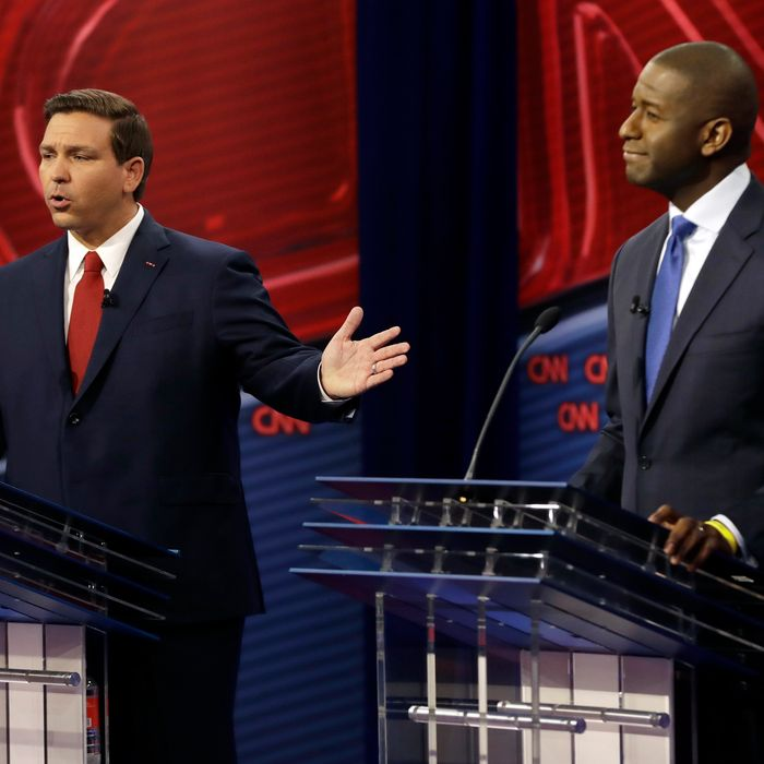 Florida Republican gubernatorial candidate Ron DeSantis, left, speaks about his Democratic opponent Andrew Gillum during a CNN debate, Sunday, Oct. 21, 2018, in Tampa, Florida.