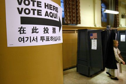 A woman leaves a voting booth on Election Day November 4, 2003 in New York City.