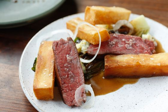 45-day dry-aged beef strip loin, gen lettuce, fried potatoes, West West blue cheese.
