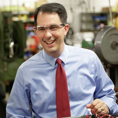 In this Sept. 23, 2014 photo Wisconsin Repubican Gov. Scott Walker makes a re-election campaign stop at a small business in Racine, Wis.