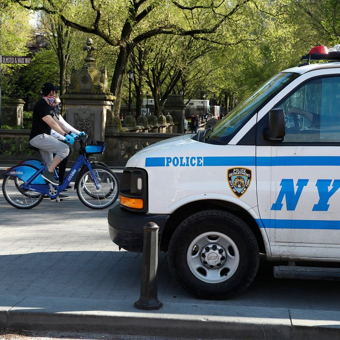 NYPD van and cyclist.