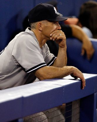 Manager Joe Girardi looks out from the dugout after 7-1 loss against the Toronto Blue Jays.