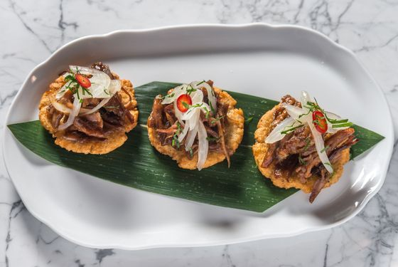 Casabe cakes with guava-barbecue pork, onion mojo, and fresno pepper
