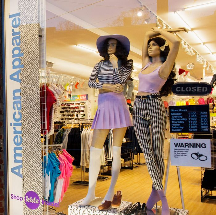 A pedestrian walks an American Apparel store in Cleveland Heights, Ohio, on April 9, 2014.