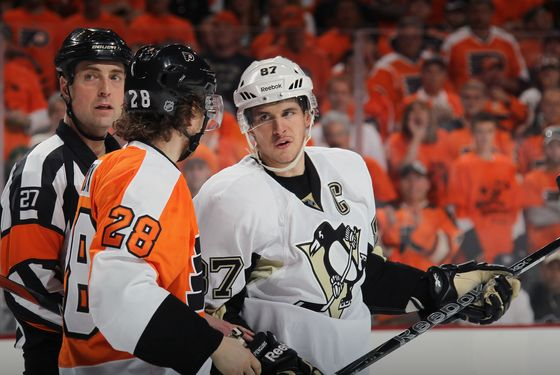 PHILADELPHIA, PA - APRIL 15:  Sidney Crosby #87 of the Pittsburgh Penguins speaks with Claude Giroux #28 of the Philadelphia Flyers in Game Three of the Eastern Conference Quarterfinals during the 2012 NHL Stanley Cup Playoffs at Wells Fargo Center on April 15, 2012 in Philadelphia, Pennsylvania. The Flyers defeated the Penguins 8-4.  (Photo by Bruce Bennett/Getty Images) *** Local Caption *** Sidney Crosby; Claude Giroux