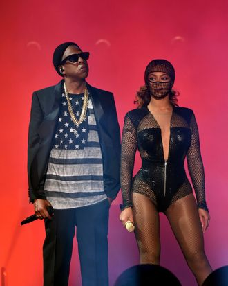 Jay-Z (L) and Beyonce perform during the