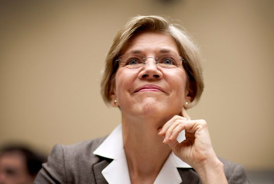 Elizabeth Warren, the Obama administration adviser on the Consumer Financial Protection Bureau, smiles before testifying at a hearing of the House Committee on Oversight and Government Reform in Washington, D.C., U.S., on Thursday, July 14, 2011. Warren said that the new agency would monitor possible violations of rules designed to protect the finances of soldiers and sailors after it starts work on July 21. Photographer: Joshua Roberts/Bloomberg *** Local Caption *** Elizabeth Warren