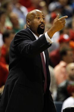 Head coach Mike Woodson of the Atlanta Hawks gives instructions to his team.