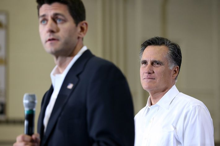 Republican presidential candidate and former Massachusetts Gov. Mitt Romney (R) looks on as Rep. Paul Ryan (R-WI) (L) speaks during a campaign rally at Randolph Macon College on August 11, 2012 in Ashland, Virginia. Mitt Romney kicked off a four day bus tour with an announcement of his running mate, Rep. Paul Ryan (R-WI).