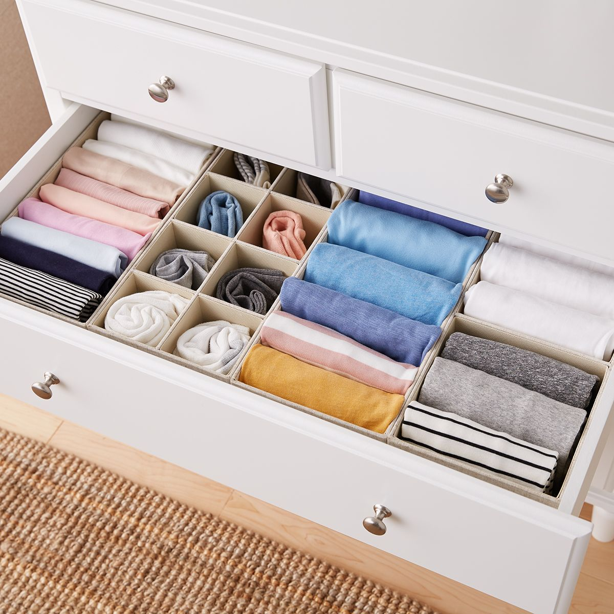 rolled clothes in dresser drawer