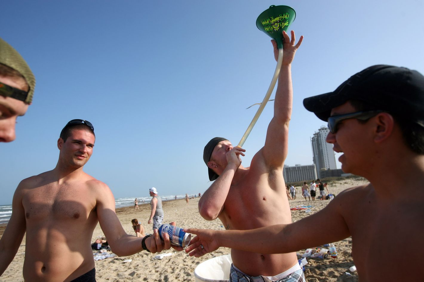 SOUTH PADRE ISLAND, TX - MARCH 25:  Students drink beer from a funnel on the beach during the annual ritual of Spring Break March 25, 2008 on South Padre Island, Texas.  The South Texas island is one of the top Spring Break destinations and attracts students from all over the country.  (Photo by Rick Gershon/Getty Images)