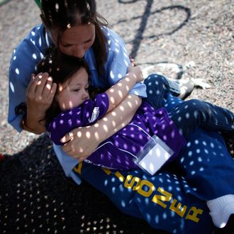 Cali Farmer hugs her mother Netta Farmer at California Institute for Women state prison in Chino