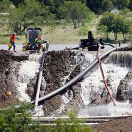 Flood Waters Threaten To Break Dam Outside Of Dallas