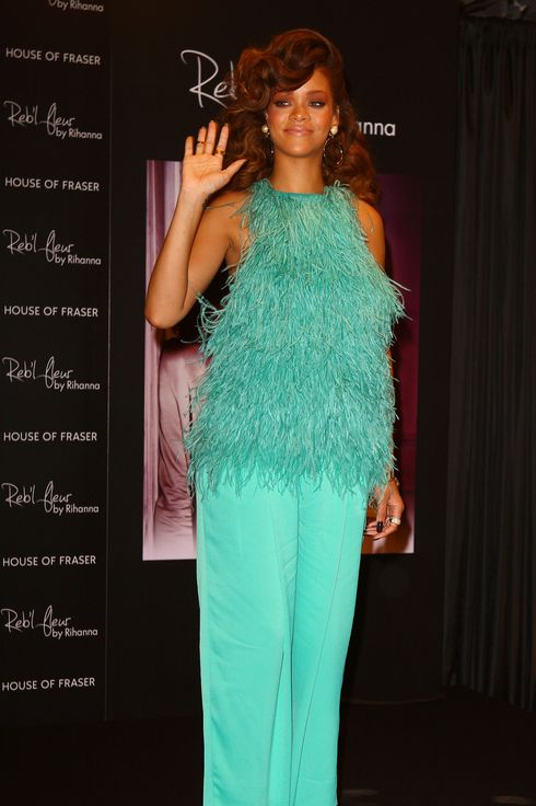 LONDON, UNITED KINGDOM - AUGUST 19: Rihanna launches her new scent 'Reb'l Fleur' at House of Fraser on August 19, 2011 in London, England. (Photo by Neil Mockford/Getty Images)