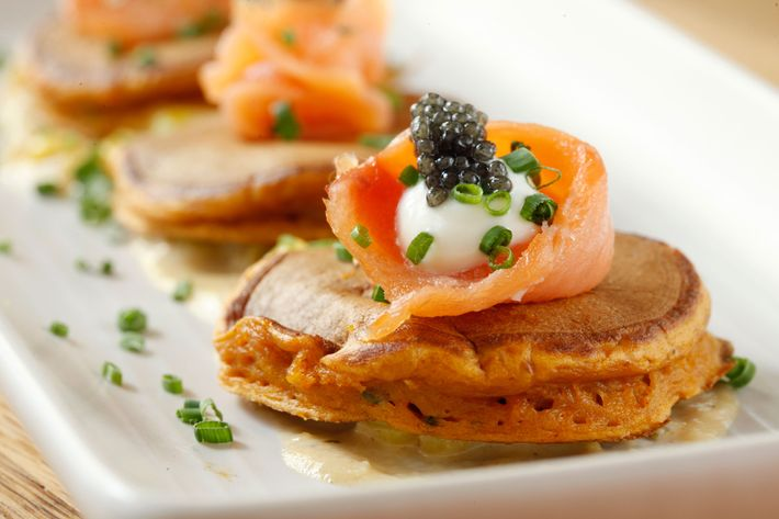 Jams pancakes with red pepper, smoked salmon, corn sauce, crème fraiche, and caviar.