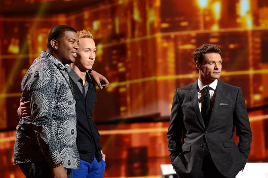 AMERICAN IDOL: Curtis Finch,  Jr. (L), Devin Velez (C) and Ryan Seacrest (R) wait to see who will be eliminated  on AMERICAN IDOL Thursday, March 14 (8:00-9:00PM ET/PT)