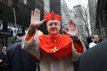 Cardinal Edward Egan waves before Timothy Dolan's Mass of Installation at St. Patrick's Cathedral April 15, 2009 in New York City. Dolan, 59, the former Milwaukee archbishop, is taking over the nation's second-largest diocese from Cardinal Edward Egan who is retiring after nine years.
