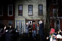 Bill de Blasio (R) is sworn in as mayor of New York City by State Attorney General Eric Schneiderman (L) while his family (L-R) Chiara de Blasio, Dante de Blasio and Chirlane McCray look on after midnight January 1, 2014 in the Park Slope neighborhood of the Brooklyn borough of New York City. De Blasio took the oath outside his home in Park Slope. His inauguration will be celebrated at noon today on the steps of City Hall when he takes the oath again, which will be administered by former U.S. President Bill Clinton.  (Photo by Seth Wenig-Pool/Getty Images)