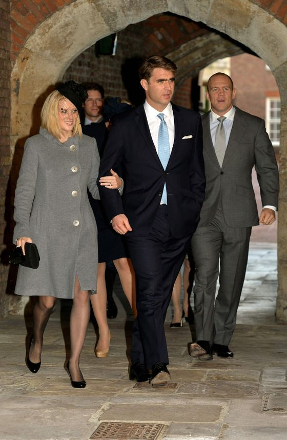 Godparent Oliver Baker (center) with his wife, Mel, and Mike Tindall.