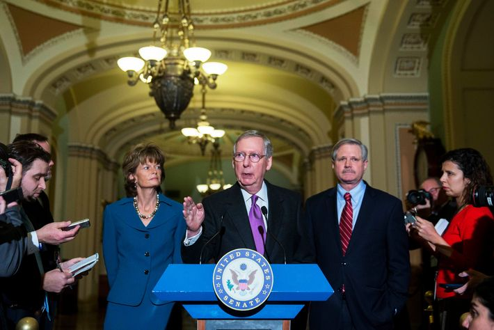 Senate Majority Leader Mitch McConnell, a Republican from Kentucky, center, speaks during a news conference with Senator John Hoeven, a Republican from North Dakota, right, and Senator Lisa Murkowski, a Republican from Alaska, after a cloture vote on the Keystone XL pipeline bill at the U.S. Capitol in Washington, D.C., U.S., on Thursday, Jan. 29, 2015.