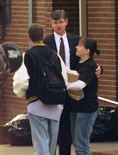 Heath High School principal Bill Bond talks with students arriving on Tuesday, Dec. 2, 1997 in West Paducah, Ky. A 14-year-old freshman boy opened fire Monday during a student prayer group meeting, killing three students and injuring five others. (AP Photo/Mark Humphrey)